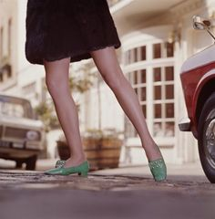 A young woman in green shoes wearing a faux fur miniskirt, circa 1970. [Miniskirt styles of the '60s and '70s | SF Unzipped | an SFGate.com blog]