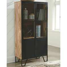 Ashley Furniture Gabinwell Bookcase with Made of metal, wood and engineered wood,Medium brown finish,Glass and metal door fronts with black doors; Wood Storage, Wood Shelves, Tall Cabinet Storage, Ashley Furniture Industries, Industrial, Wood And Metal, Black Metal, Cabinet Handles, Wood Planks