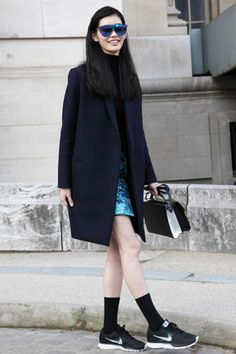Ming Xi looks chic in a sleek topper and bright mini. #PFW