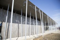 A combination of glass, timber facades, and a zinc canopy.