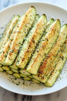 Crisp, tender zucchini sticks oven-roasted to absolute perfection. It's healthy, nutritious and completely addictive! Zucchini and parmesan cheese. It's a match made in heaven. Parmesan Zucchini Fries, Zucchini Crisps, Healthy Zucchini, Zucchini Soup, Courgette Recipe Healthy, Baked Zuchinni Recipes, Parmesan Roasted Zucchini, Oven Roasted Zucchini, Baked Zucchini Sticks