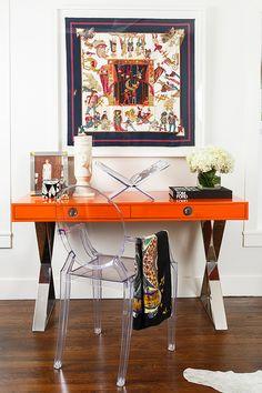 Love the orange desk and framed scarf
