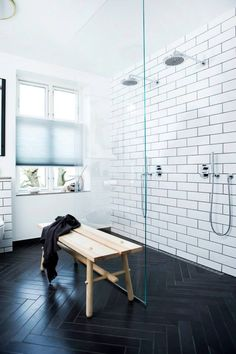"Black and white bathroom tiles & wooden bench. Black ""wood"" procelain tiles on floor"