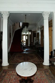 "Beautiful corinthian columns frame the entrance to the mahogany starcase. Madewood Plantation – Circa 1846  Madewood Plantation is truly a treasure among Louisiana plantation homes. Located near the banks of Bayou Lafourche in Napoleonville, LA. Madewood is a huge Greek Revival mansion made from wood harvested on the property, which is why it was named ""Madewood""."