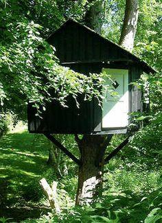 Cozy child's treehouse in Denmark.