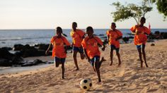 PORT LOUIS, MAURITIUS - MAY 28: Children of the NCB Sports Academy enjoy a game of football at the Mauritius Resort on May 28, 2013 in Port ... Mauritius Resorts, Football Photos, Play Soccer, Creative Kids, Fifa, Kids Playing, Photo Galleries, Game, Children