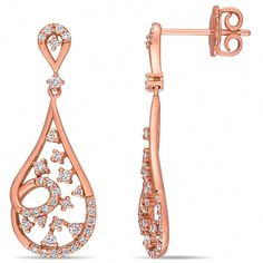 These amazing drop earrings feature round white diamonds crafted in 14-karat rose gold. These exquisite earrings are secured with butterfly backs. #SilverDropEarrings Diamond Drop Earrings, Silver Drop Earrings, White Diamonds, Butterfly, Rose Gold, Amazing, Crafts, Diamond Earrings, Silver Earrings