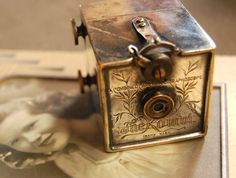 Cool old camera sitting on top of my mom's picture