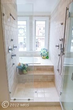 LOVE this! This solves many problems for us--space, access to the tub as I get older, large comfortable shower space. LOVE THIS!!! I love the window over the tub too, although I would use something translucent instead of a regular window.