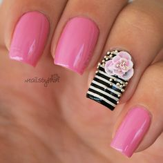 Pink Nails With Black and White Stripes and Flower Accent.
