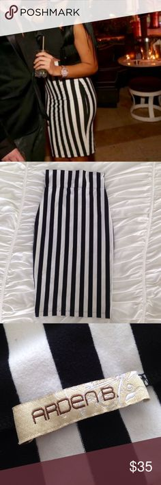 Stripe Bodycon Midi Skirt Black and white stretchy body hugging midi skirt. Flattering vertical stripes. Size M from Arden B. Arden B Skirts Midi