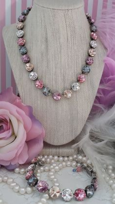 BASHFUL!!! New 12mm Genuine Swarovski Designer Inspired Crystal Necklace. Beautiful Soft pattern that looks Fabulous on All Skin tones! Great Combination that will give you great Versatility! BASHFUL contains 12mm Crystals in Soft Lt. Rose, Cool Violet, Blue Shade, and Sparkling Silk and Crystal! Whether youre dressed in Jeans on a summer afternoon or Dressed to kill in a Sexy Slinky Dress Bashful will compliment your outfit perfectly and fashionably! Listing is for one Bashful necklace…
