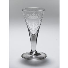 A DUTCH ENGRAVED VOC WINEGLASS, CIRCA 1740 the flared bowl engraved with a crowned coat of arms bearing the initials VOC flanked by tendrils, the opposite side bearing the inscription HET.WELVAREN.VAN.DE.OSTDIENISCHE.KOMPANCE