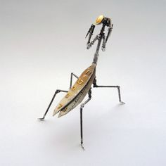 mechanical arthropods and insects made from watch parts and light bulbs/
