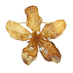 Gold and Diamond 'Dahlia' Flower Brooch, Tiffany & Co.   18 kt., 6 round diamonds ap. .50 ct., signed Tiffany & Co., ap. 15.2 dwt. With signed box.