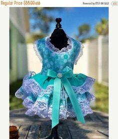 Made of soft cotton for your fur baby's comfort, this cute little dress will make her strut her stuff! A beautiful custom Made bow with pearl and crystal accent is just to pretty! Bodice is lined and interfaced. Will Custom fit your fur baby