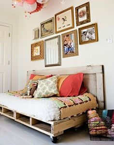 Found on shelterness, but found the blog before. Such a cute room. I really like the layering of patterns and textures. The door and pallet make a maximum impact for a minimum budget. Also pinned this for the picture and frame arrangement over the bed.