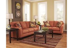 """The Gale Sofa from Ashley Furniture HomeStore (AFHS.com). With the sweeping contemporary flared arm design surrounded by soft feel of the rich toned upholstery fabric, the """"Gale-Russet"""" upholstery collection creates a warm inviting atmosphere perfect for any living area while giving the comfort you deserve."""