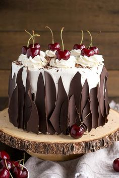 This Black Forest Cake combines rich chocolate cake layers with fresh cherries, cherry liqueur, and a simple whipped cream frosting. | livforcake.com
