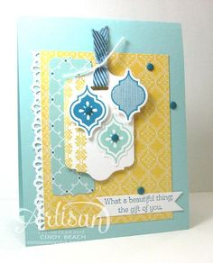beautiful handmade card by Cindy Beach ... blue, yellow, white .... Quatre Fancy Suite ... patterned papers with subtle designs here ... tag ... punched tiles ... punched fans border ...  candy dots ... just right because everything in the same colors ... Stampin' Up!