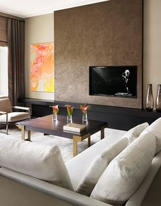 By placing TV off centre it creates tension in the design which makes it an interesting feature rather than just a TV | hotel, luxury, interior design, hotel decor. More inspirations at http://www.bocadolobo.com/en/inspiration-and-ideas/