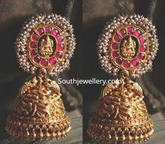Jewelry OFF! 22 carat gold antique Lakshmi jhumkas adorned with rubies and pearls by Navrathan Jewellers. Pearl Jhumkas, Gold Jhumka Earrings, Indian Jewelry Earrings, Jewelry Design Earrings, Gold Earrings Designs, Indian Wedding Jewelry, India Jewelry, Antique Earrings, Bridal Jewelry