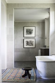 love the color of faint greys and whites     marble + stone tile in bathroom design by Thomas Hamel.  just oversized tiles perhaps.
