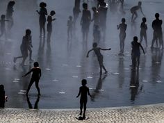 People cool down in a fountain beside Manzanares river in Madrid, Spain. Madrid has been experiencing hot weather this week as temperatures reach up to 39 degrees Celsius (102 Fahrenheit) on Thursday.