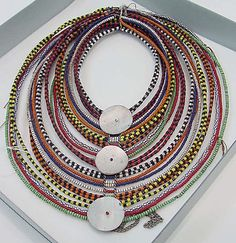 Africa | Early 20th century Maasai necklace | Glass beads, fiber and shell buttons.