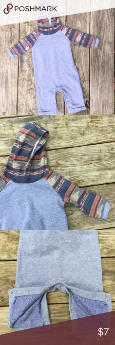 Warm hooded jumpsuit for baby. 3-6 month hooded onesie for baby. Very soft and comfortable. Warm for fall and winter. Snap closure on the legs. A little bit of pilling from the wash. Otherwise in great condition. Old Navy One Pieces Bodysuits