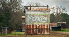 An old Dr. Pepper ad painted onto the side of an abandoned tobacco barn in North Carolina. This was popular advertising in the old south. The barn owner would receive a crate of cola every year as payment.