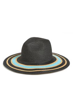 Love the pop of turquoise color on this chic striped brim floppy hat!