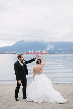 Bride and Groom dance on the beach - wedding photo idea   Fab Mood