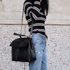 black fitted tee, gray stripes, black crossbody