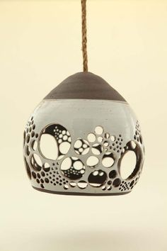 Heather Levine's ceramic hanging pendant lights - Maybe with swirls?