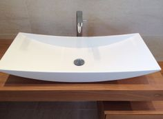Wash basin in Tecnoril, mixer Elidere Alpha from Hego, top in cherry wood from Arlex. Renovation of mater bathroom in Le Rouret (Côte d'Azur). Id Deco conception. Niagara realisation.