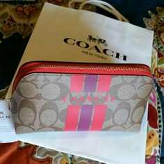 {HAVE} Coach racing stripes makeup or jewelry pouch.
