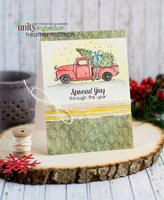 """Created by Angie Blom. This kit contains 3 stamps.  Truck hauling Christmas tree measures approximately 2"""" x 3.25"""".  """"Spread Joy through the year"""" sentiment measures approximately .5"""" x 1.75"""".  """"Merry Christmas"""" sentiment measures approximately .5"""" x 2"""".  All Unity Stamps are pre-cut, mounted on cling foam and ready to use right out of the package – you can mount our stamps on any acrylic block.  Unity is known for its HIGH QUALITY red rubber stamp – to be used for years to come."""