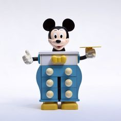 A mickey mouse bedside chest of drawers edited for Disney by Starform, France 1990's.  Moulded plastic, wood.