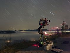 Window to the Once Secret Sky    Credit & Copyright: Peter Wienerroither (U. Wien)    Pictured above is a small telescope being deployed at picturesque Hohe Wand, about 50 kilometers south of Vienna, Austria. The spin of the Earth is visible in the above photo as the long star trails.