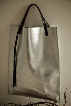 flat, handmade silver tote