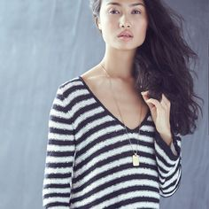 Free People has those perfect summer sweaters with just enough cozy for fall.
