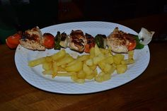 Skewer with fries at a small local restaurant in MIjas Costa (Málaga) Spain.