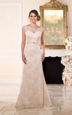 Stella York #6043 - This vintage-inspired Lace over matte-side Lustre Satin modified A-Line gown from the Stella York wedding dress collection features a modern illusion neckline and cap sleeves.