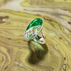 Two pear shaped gems are seamlessly set in this diamond and emerald ring creating the illusion of a perfect oval. The pear shaped Colombian no oil emerald weighs over 4 carats and is nestled against a three and half carat pear-shaped diamond. #formsjewellery #colombianemerald #emeraldring #diamondring