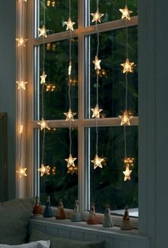 Christmas star lights in front of the window