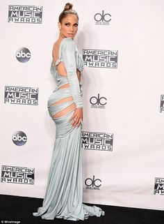 How low can J-Lo go? Jennifer Lopez dressed in little more than a few strands of silk