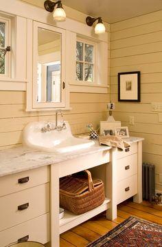 Vintage 1920s bathroom sink and cabinets renovation detail