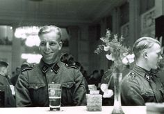 Norwegian volunteers of the Regiment Nordland (part of Wiking Division) on social evening on the occasion of the visit of Reichsführer-SS Heinrich Himmler. Date: 22 April 1941, location probably Lager...