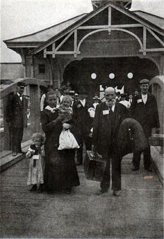Immigrants in 1904 after being processed at Ellis Island.